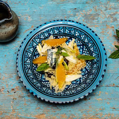 Couscous con gorgonzola piccante, arance, olive taggiasche, menta, finocchio a velo