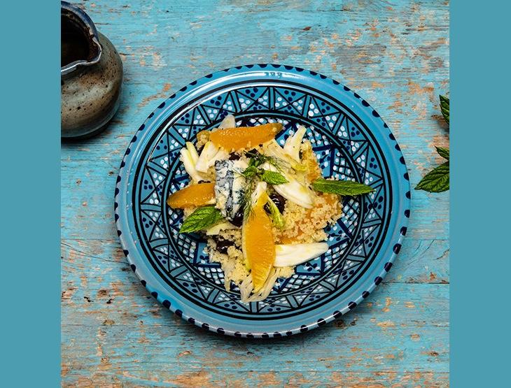 Couscous con gorgonzola piccante, arance, olive taggiasche